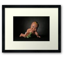 Baby and a turtle Framed Print