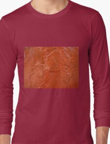 Thick and uneven layer of red paint on a wall closeup Long Sleeve T-Shirt