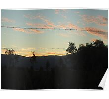 sunset through barb wire fence Poster