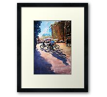 Bicycle shadows on the sunny street Framed Print