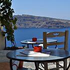 A Scenic Cafe Overlooking Caldera by Katerina Vorvi