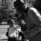 On the sidewalk... by Rene Fuller