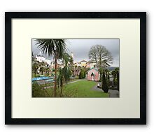 Portmerion Wales, colourful houses with storm brewing. Framed Print