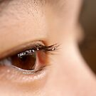 brown eyes with drops on lashes by lensbaby