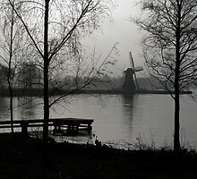 The windmill at the lake by sunshine8