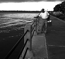 Storm's coming....time to quit fishing. by Vince Russell