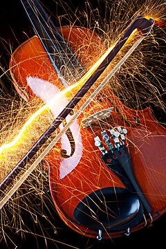 Violin with sparks flying from the bow by Garry Gay