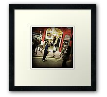The man with the sign Framed Print