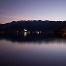 View across Lake Bled at dusk by Ian Middleton