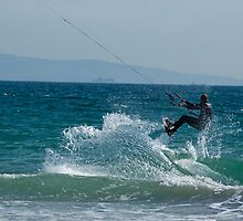 Kite surfer jumping over a wave, Playa de los Lances, Tarifa, Spain. by Sami Sarkis