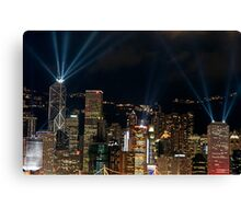 Laser show over city at night, Hong Kong, China. Canvas Print