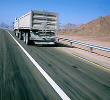 Egypt, Sinai Desert, lorry on highway (blurred motion) by Sami Sarkis