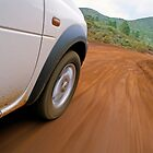 New Caledonia, Grand Terre Island, car on road (blurred motion) by Sami Sarkis