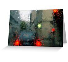 Traffic lights in rain, view through windscreen Greeting Card