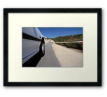 Speeding  car on road Framed Print