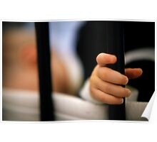 Baby girl (12 months) holding bar of cot Poster