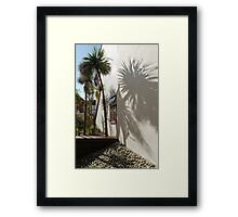 Palms by the wall Framed Print