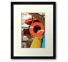Kayaks At the Waters Edge Framed Print