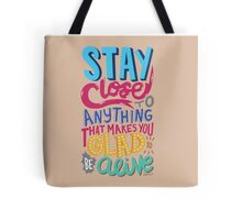 Stay Close to Anything That Makes You Glad to Be Alive Tote Bag