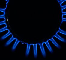 Lit blue gas ring, close-up by Sami Sarkis