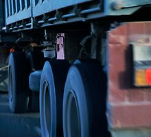 Truck Wheels On A Highway by Sami Sarkis