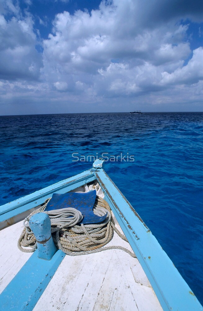 Deck and bow of diver's boat at sea by Sami Sarkis