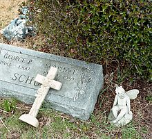 Gravestone and Fallen Cross by Robert Noll
