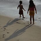Shadow play -  siblings at the beach by Bernhard Matejka