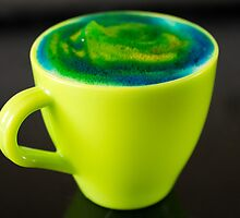 Swirly green foam in a green tea cup by claire87