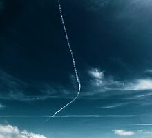 Jet trails over the beach by Ray Smith
