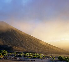 Ash plains around Mount Yasur at sunset by Sami Sarkis