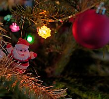 Baubles and Santa Claus on Christmas tree by Sami Sarkis
