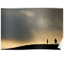 Silhouettes of two people standing on horizon, dusk Poster