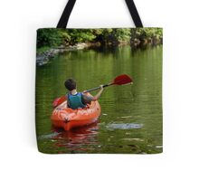 Boy kayaking in river Tote Bag