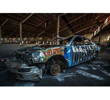 Abandoned car in an abandoned warehouse Photographic Print