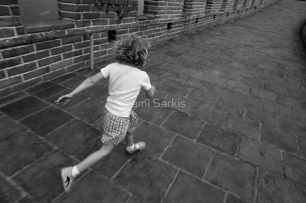 Girl running away on Great Wall of China by Sami Sarkis