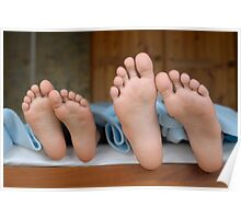 Two children (6-12) lying in bed, focus on feet, close-up Poster
