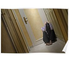 Depressed woman sitting in corridor with head in hands Poster