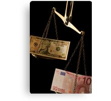 Ten Euro banknote outweighing ten US dollar bill on scales Canvas Print