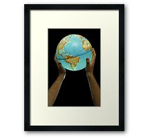 Man holding illuminated Earth globe Framed Print