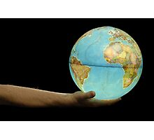 Man offering illuminated Earth globe Photographic Print