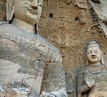 Giant Buddha statues in Yungang Shiku caves by Sami Sarkis