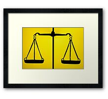 Silhouette of weighing scales Framed Print