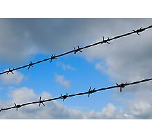 Barbed wires against cloudy sky Photographic Print