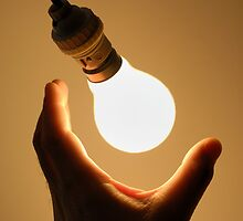 Man catching swinging light bulb by Sami Sarkis