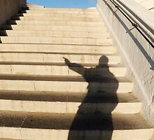Man casting shadow on steps by Sami Sarkis