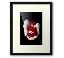 Woman holding Yin Yang balls in hand Framed Print