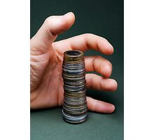 Hand surrounding stack of coins Photographic Print