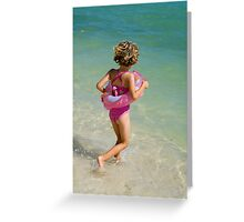 Girl running into water on beach Greeting Card