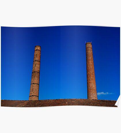 Two chimneys against blue sky Poster